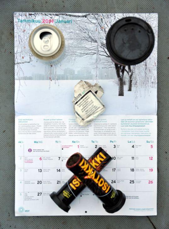 Kalenteri avoinna tammikuun kohdalta, päällä oluttölkki, noutokahvimuki, rytistetty tupakka-aski ja kaksi räjähtänyttä ilotulitetta.