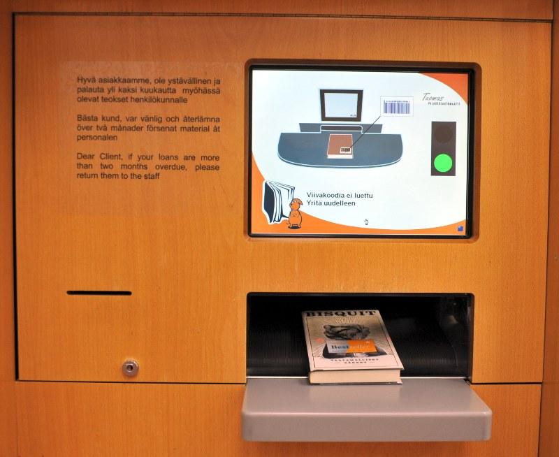Kirjaston liukuhihnallinen palautusautomaatti.